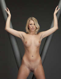 Playing in the Vee is this blonde with a serious look and clean shaven pussy. - Danielle Maye - Presenting Danielle