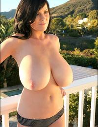 Rachel Aldana poolside in a pink bikini