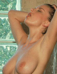 Nikita Marie washes her body in a hot shower