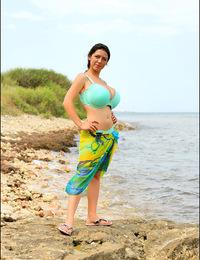 Anya Zenkova topless on the beach