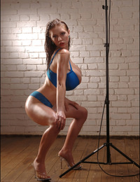 Anya Zenkova in blue, plays with lightstand