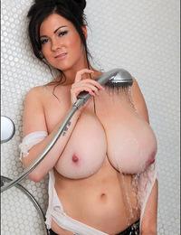 Brunette Rachel drenches huge boobies in the shower