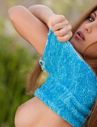 Andie Valentino takes off her blue top